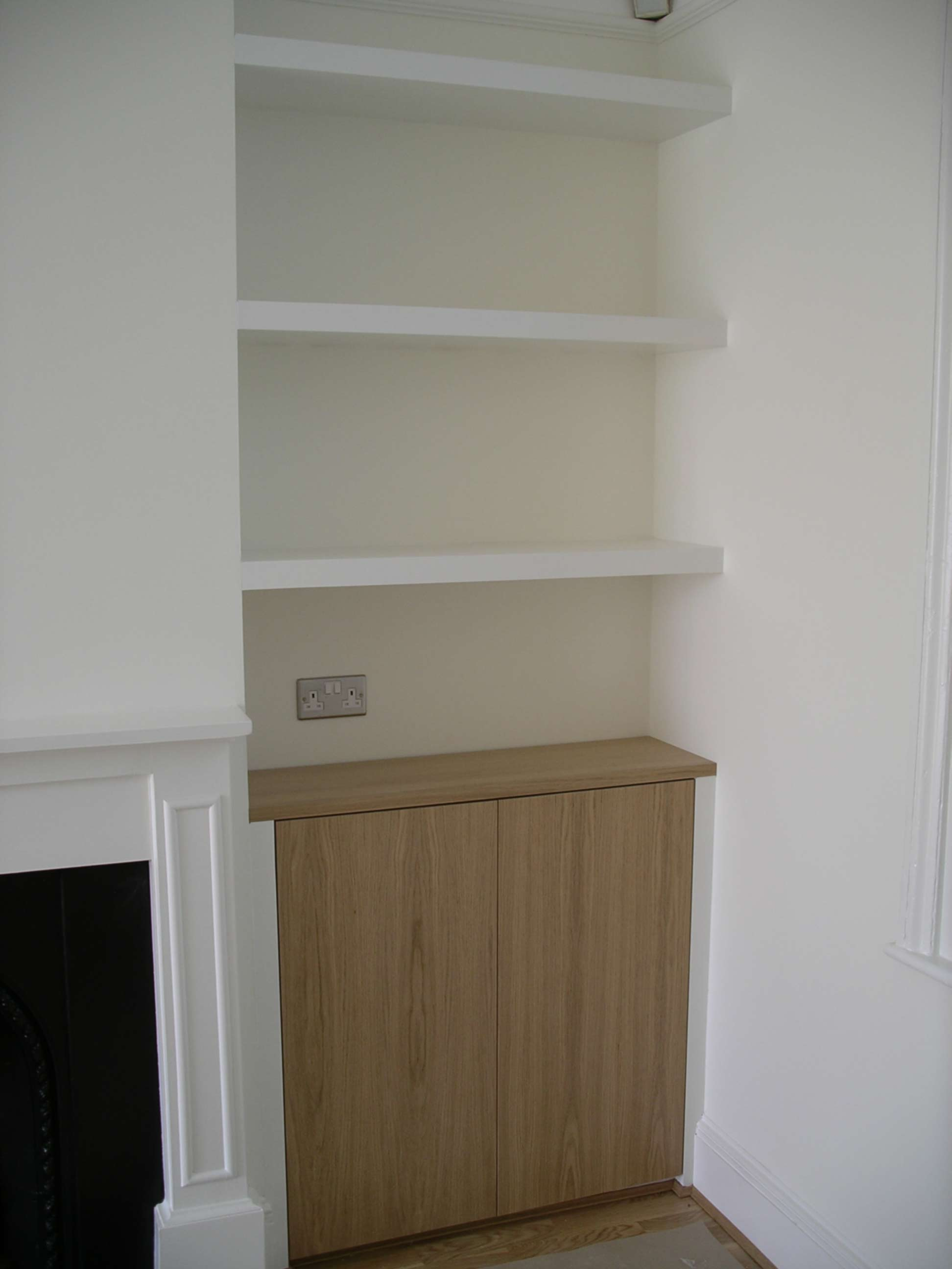 custom made alcove cupboard with oak doors and chubby shelves