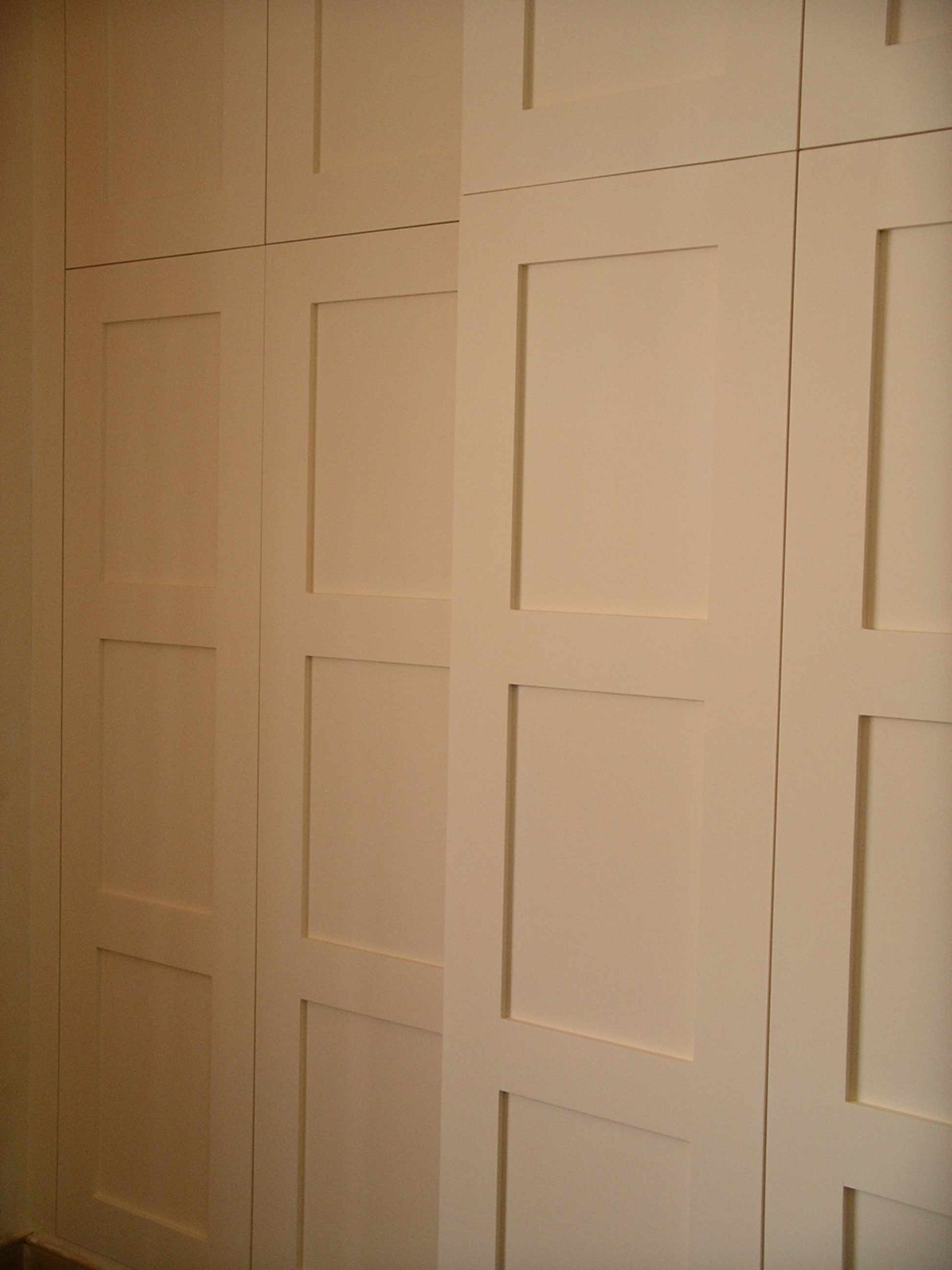 wardrobe hidden behind library panelling