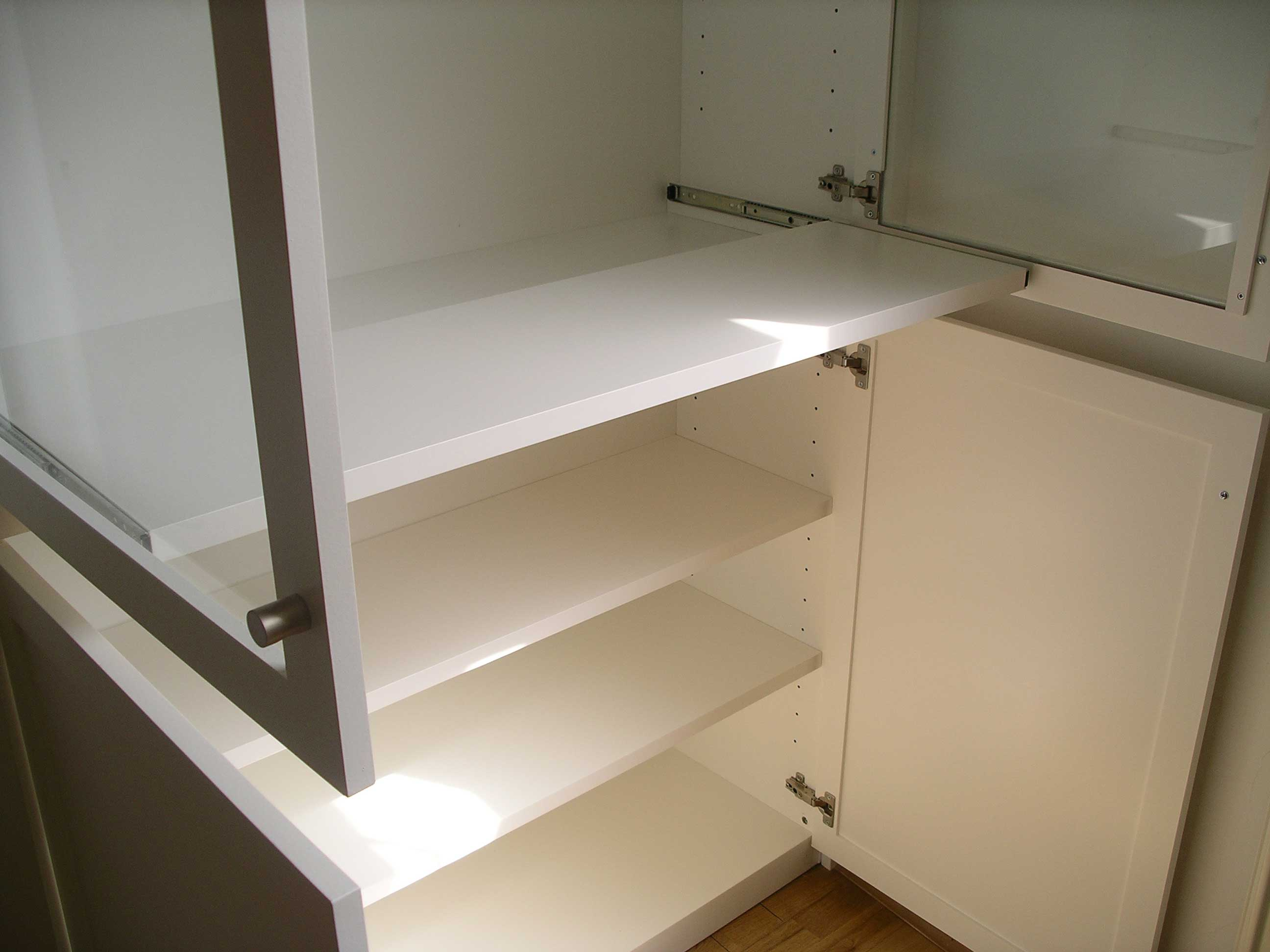 pull out shelf in bespoke cabinet