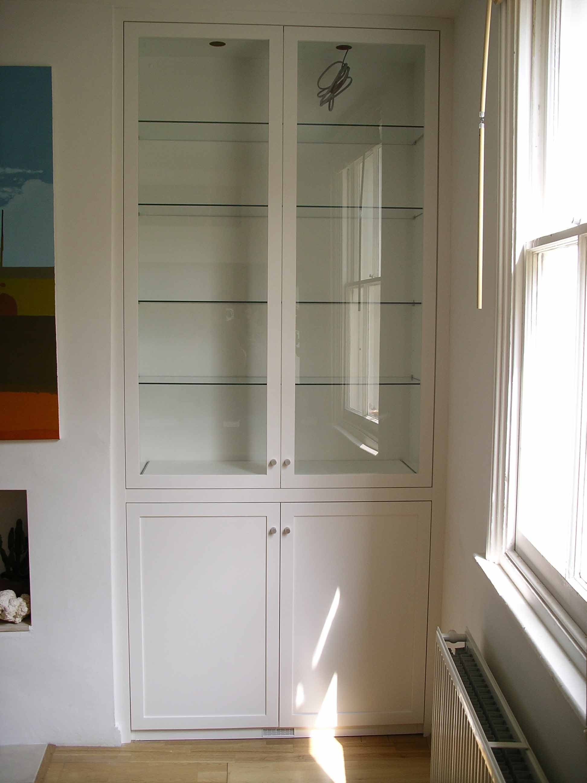 glazed alcove cabinet with glass shelves