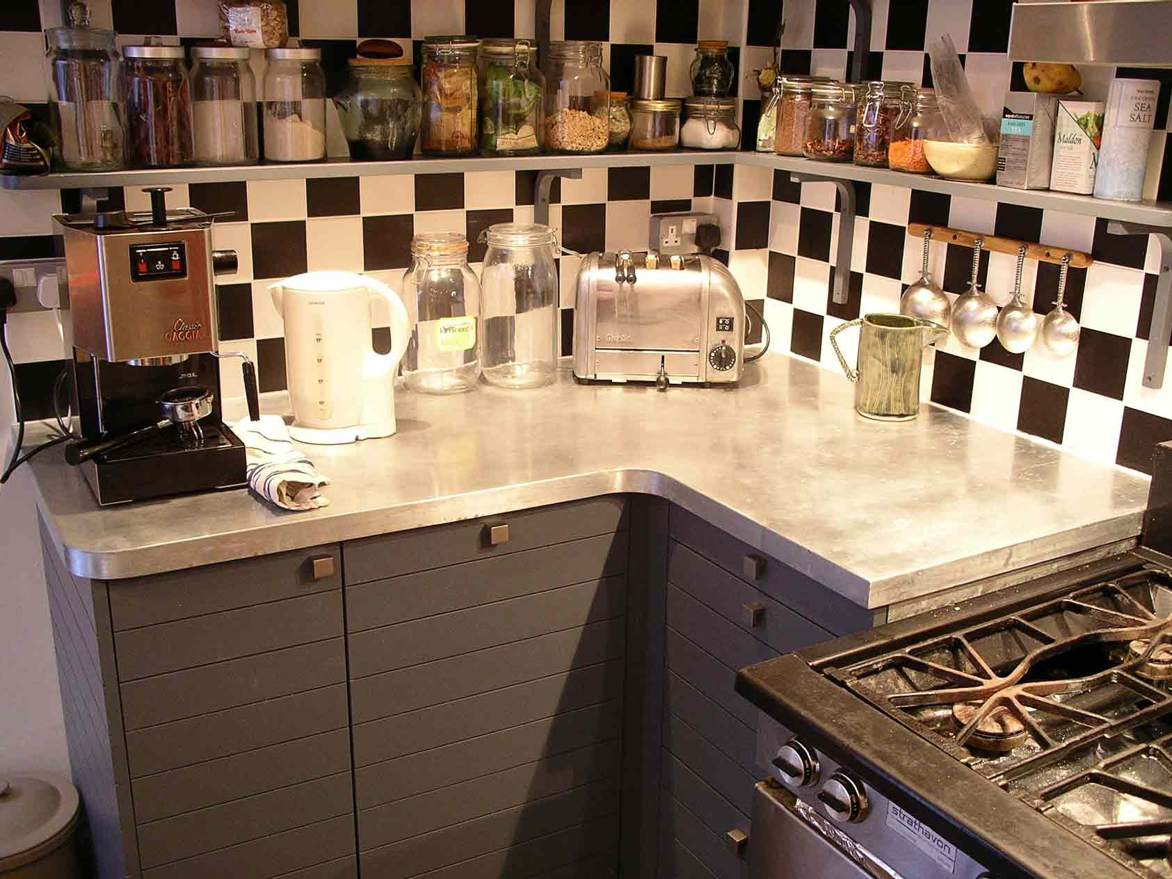 bespoke kitchen cabinets with horizontal slatted doors and custom made zinc worktop