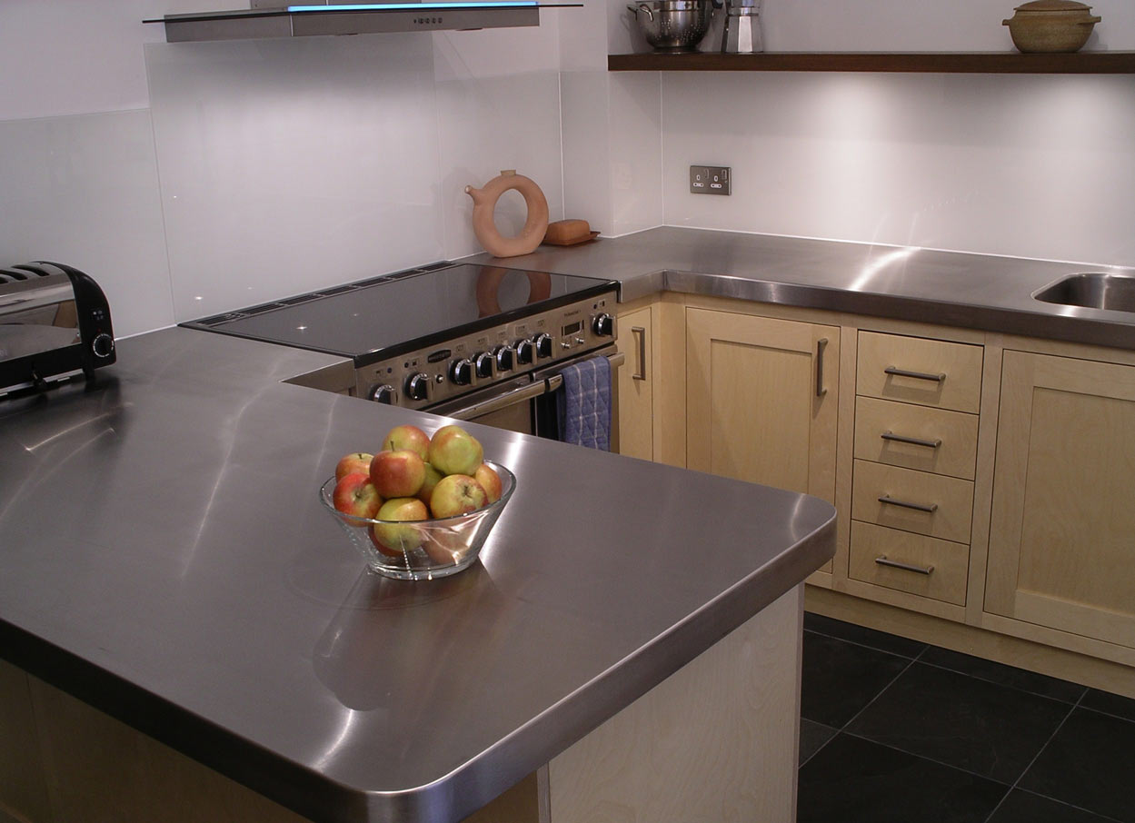 breakfast bar custom made in stainless steel  for bespoke fitted kitchen
