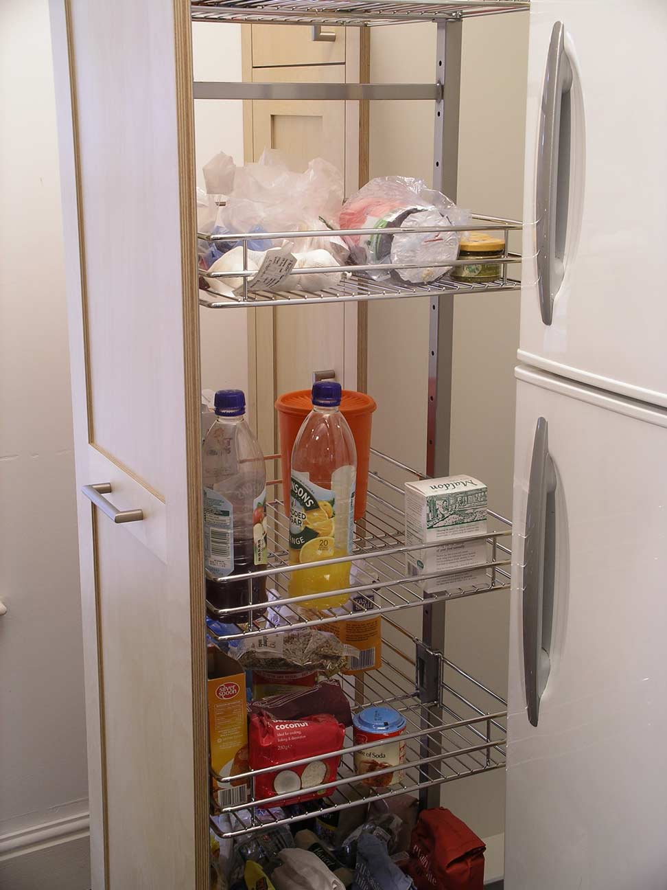 pull-out larder storage in custom made cabinet
