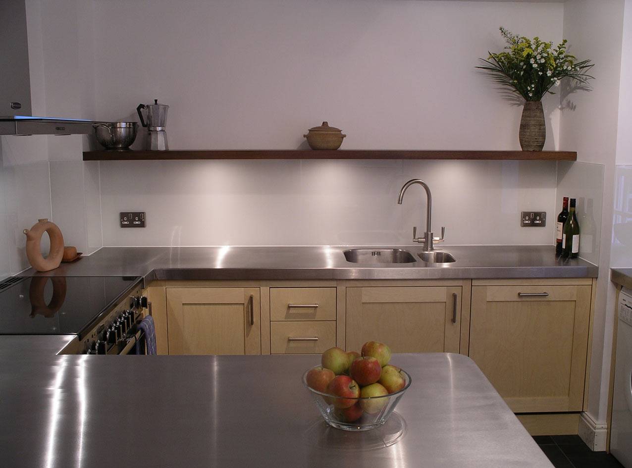 custom built fitted kitchen with stainless steel worktops