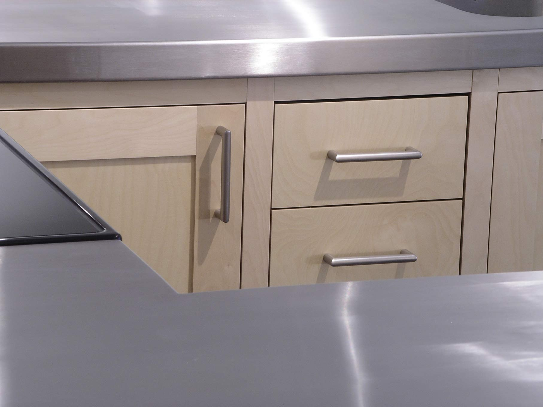 stainless steel worktop and kitchen drawers fitted kitchen by Peter Henderson Furniture