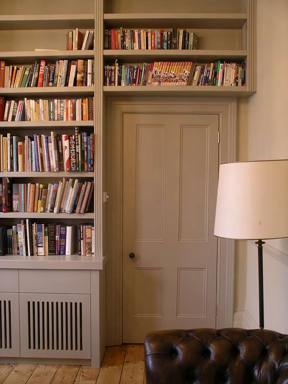 fitted bookcase extends over the door