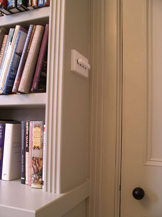 light switch built in to bookcase side