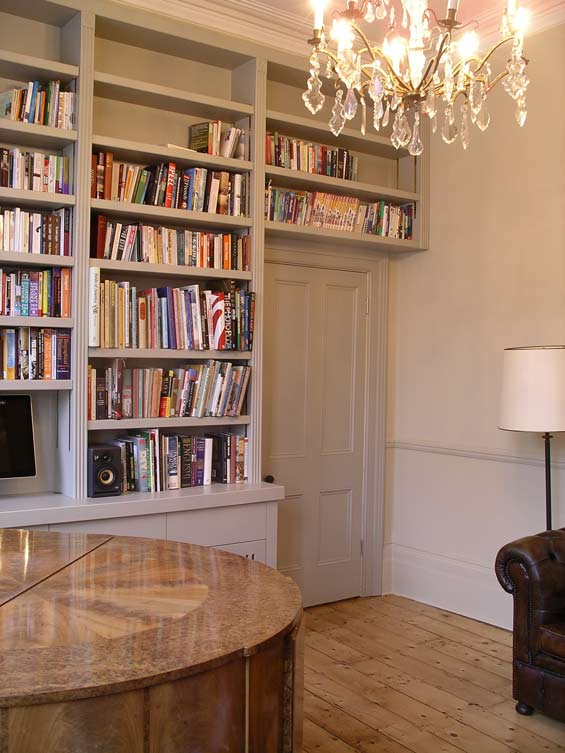 bespoke fitted hand painted bookcase with cupboards