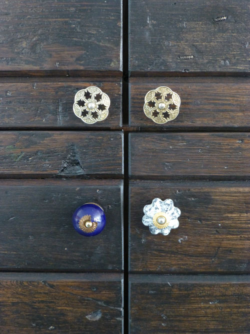 junk shop knobs on custom made plank kitchen