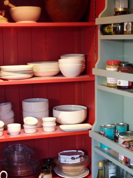 classic larder cupboard interior view showing shelving on doors