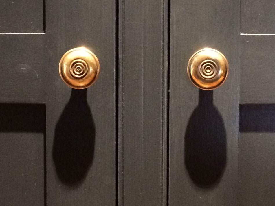 brass knobs on bespoke wardrobe