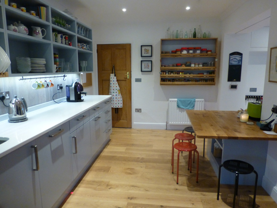 bespoke kitchen with open cupboards