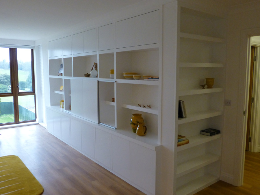 fitted bookcase with hidden television storage
