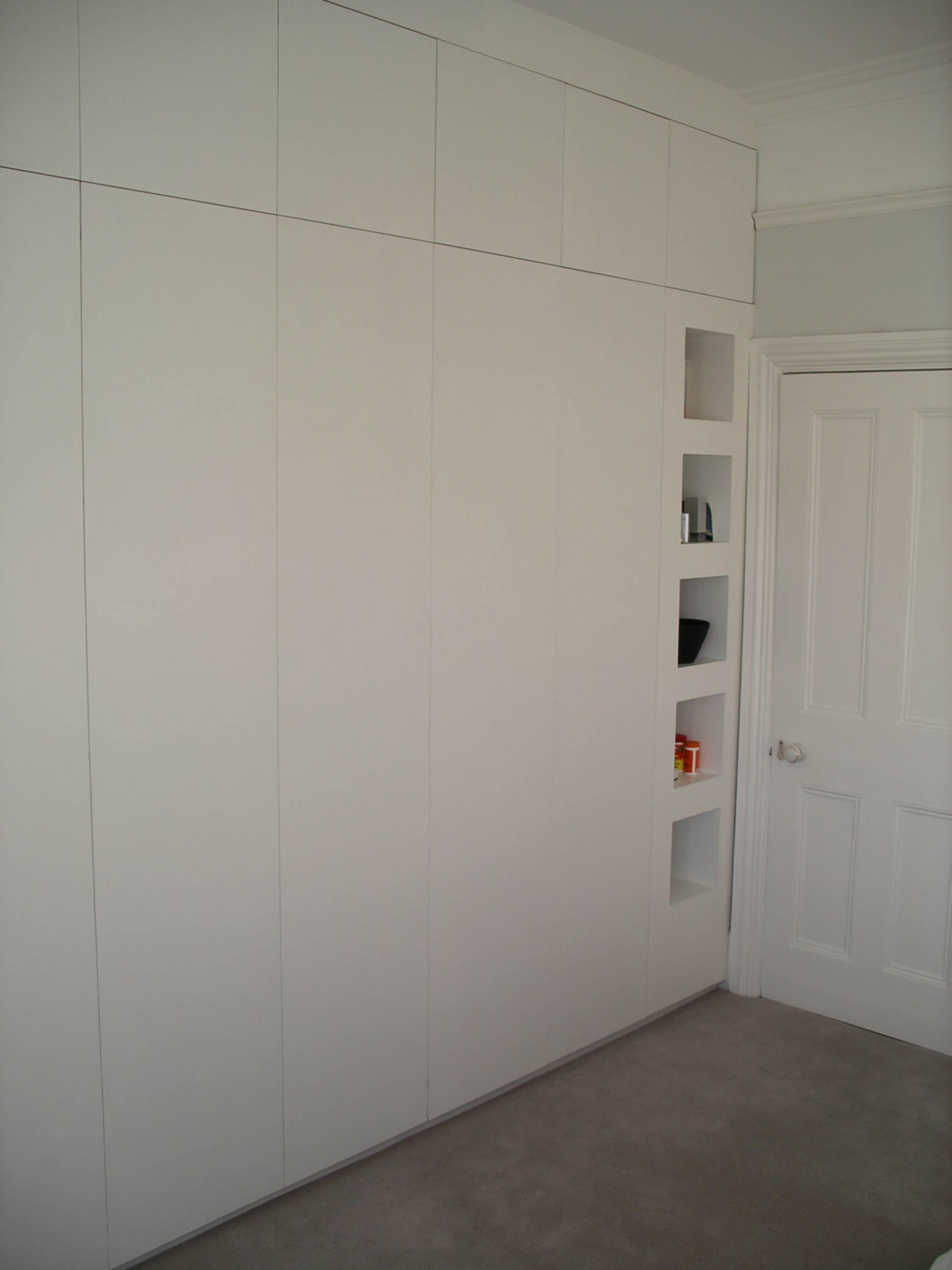 fitted wall to wall and floor to ceiling wardrobe