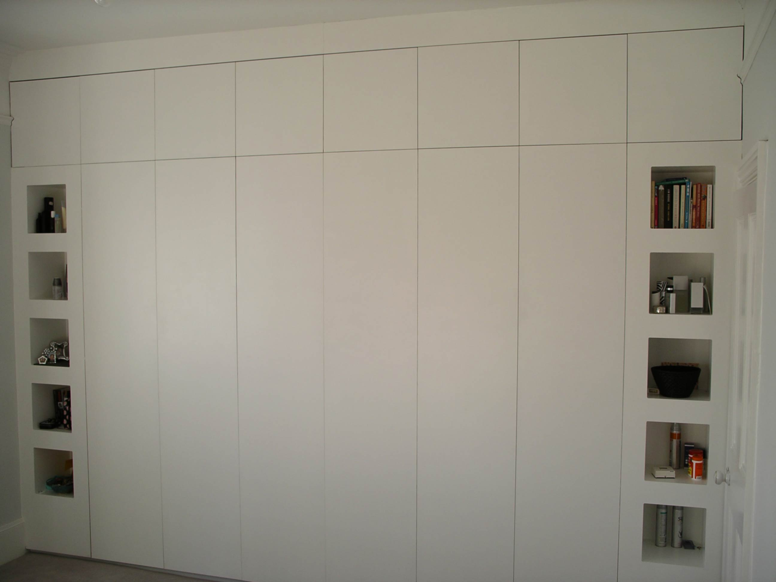 floor to ceiling fitted bespoke cupboard