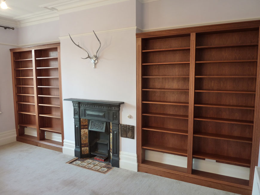 bespoke fitted mahogany and sapele bookcases