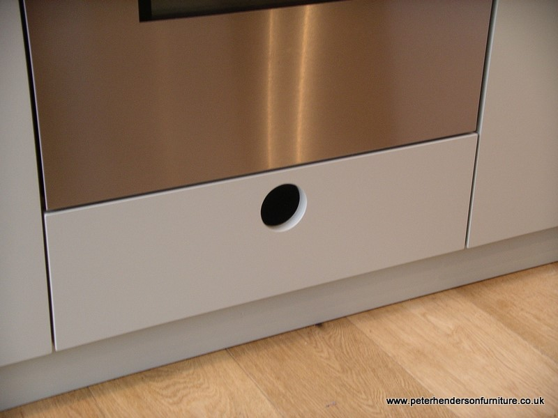 bespoke kitchen storage under oven