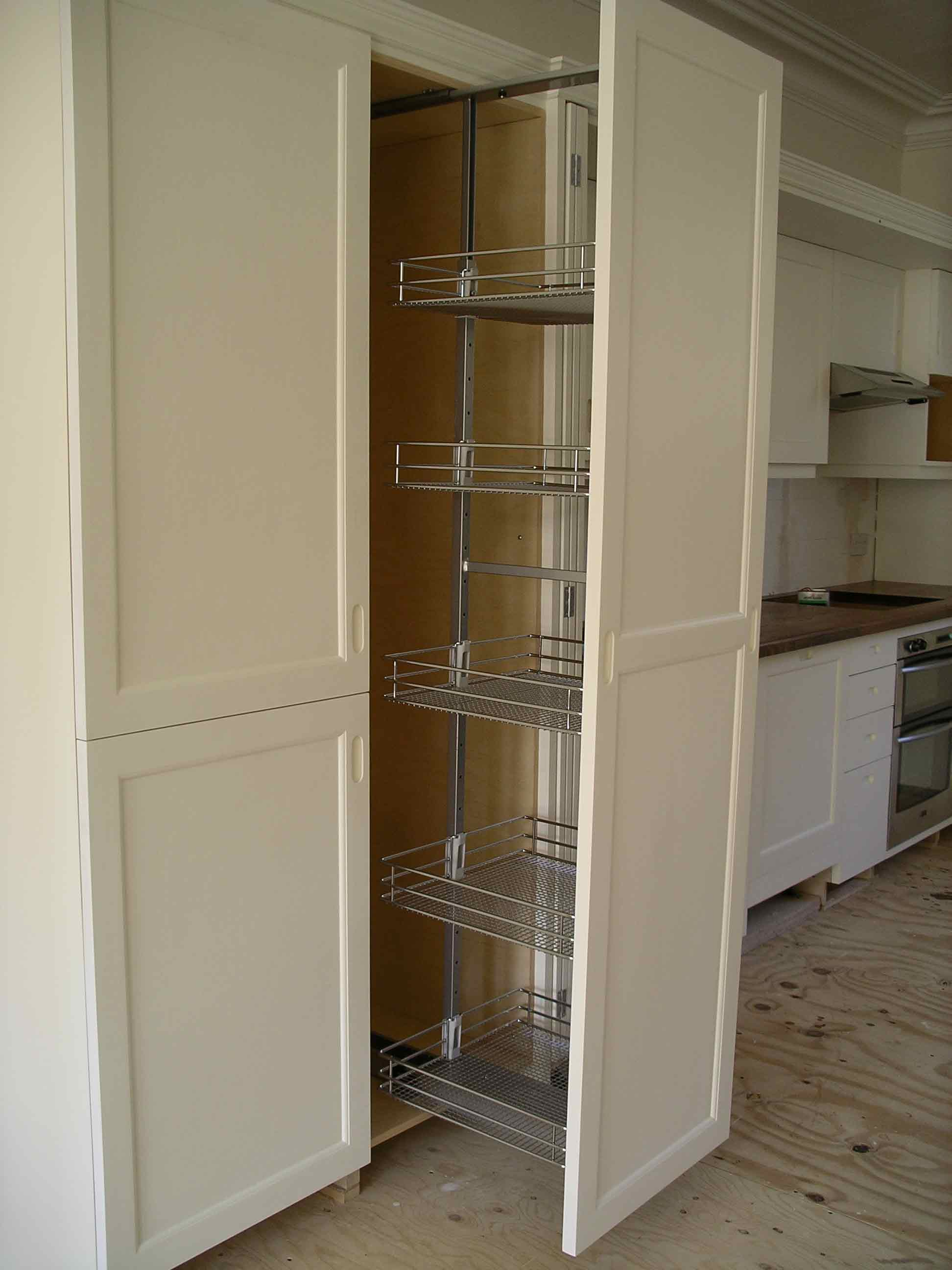 pill-out larder baskets in handmade kitchen