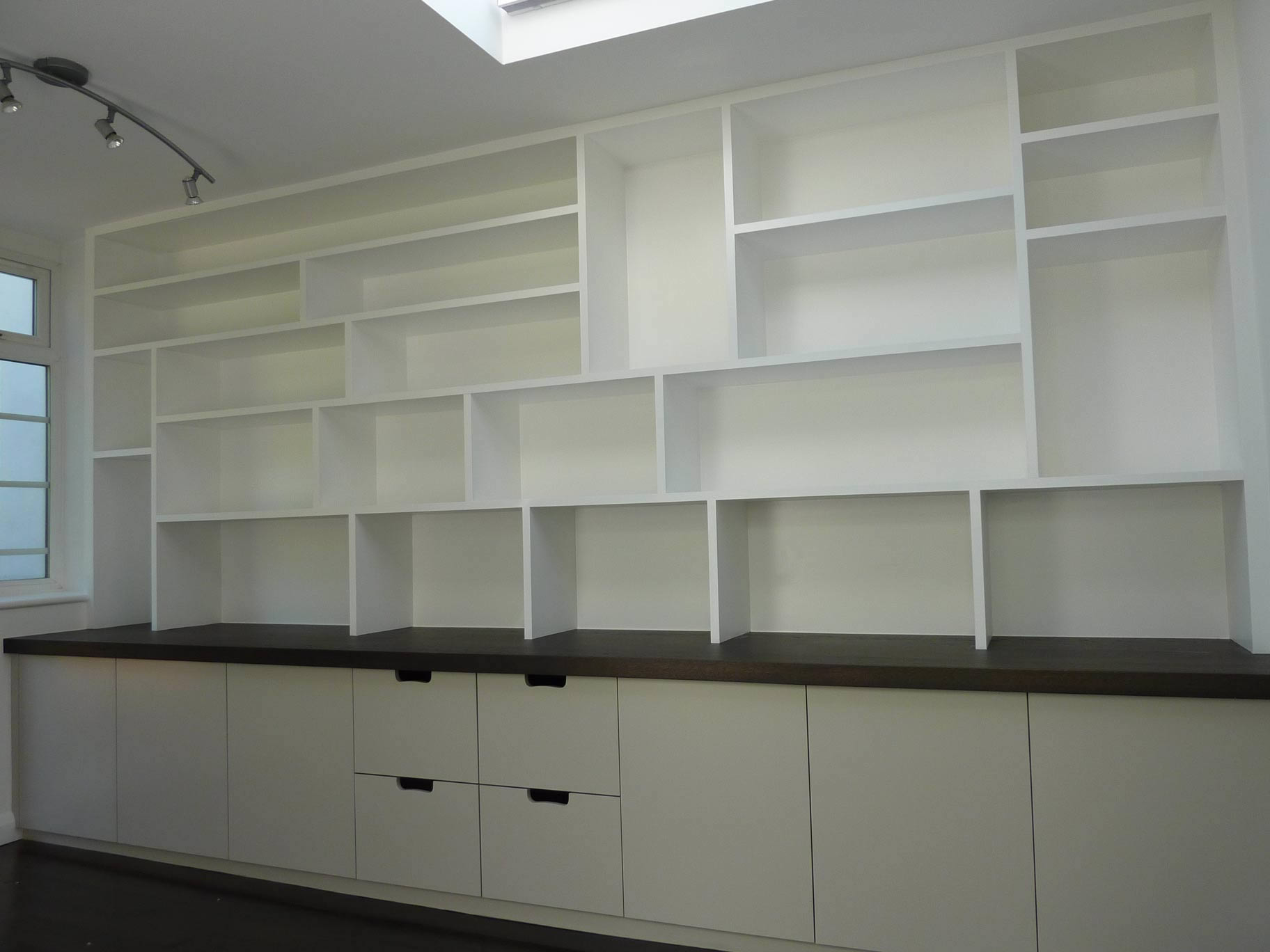 fitted study with pigeon-hole shelving