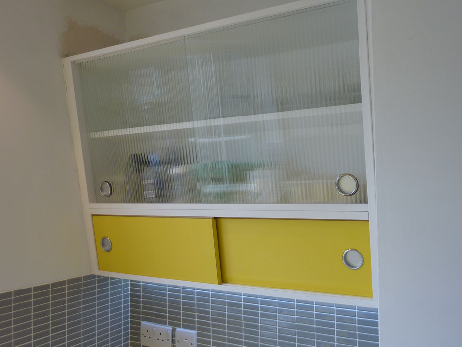1950's style angled wall cabinet with formica and reeded glass doors custom made