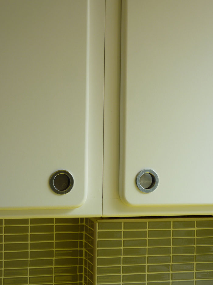 inset chrome handles in radiused surface mount 1950's style kitchen door
