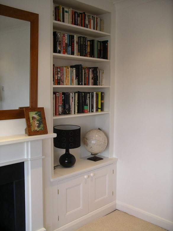 fiitted alcove bookcase with cabinet