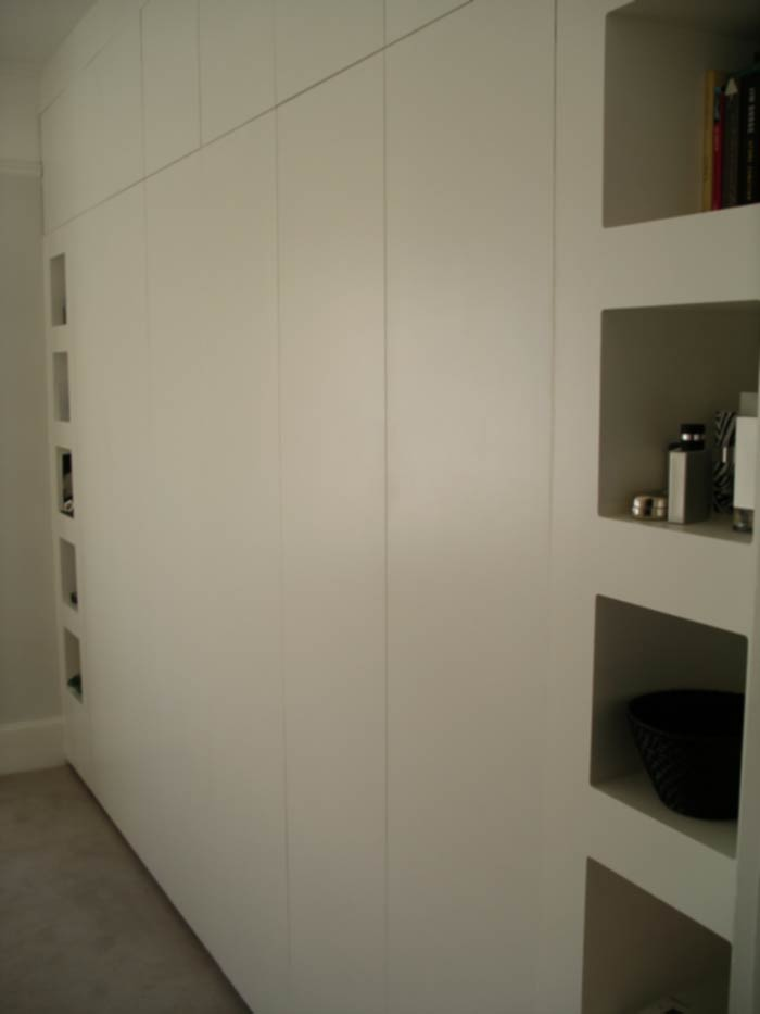 contemporary fitted wardrobe with push-click doors
