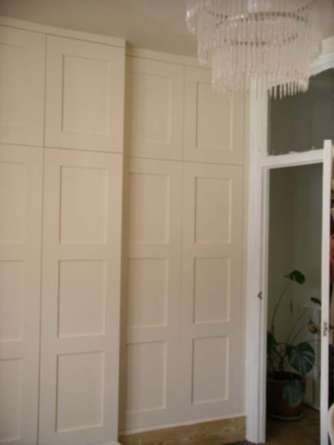fitted traditional style wardrobe with panelled doors