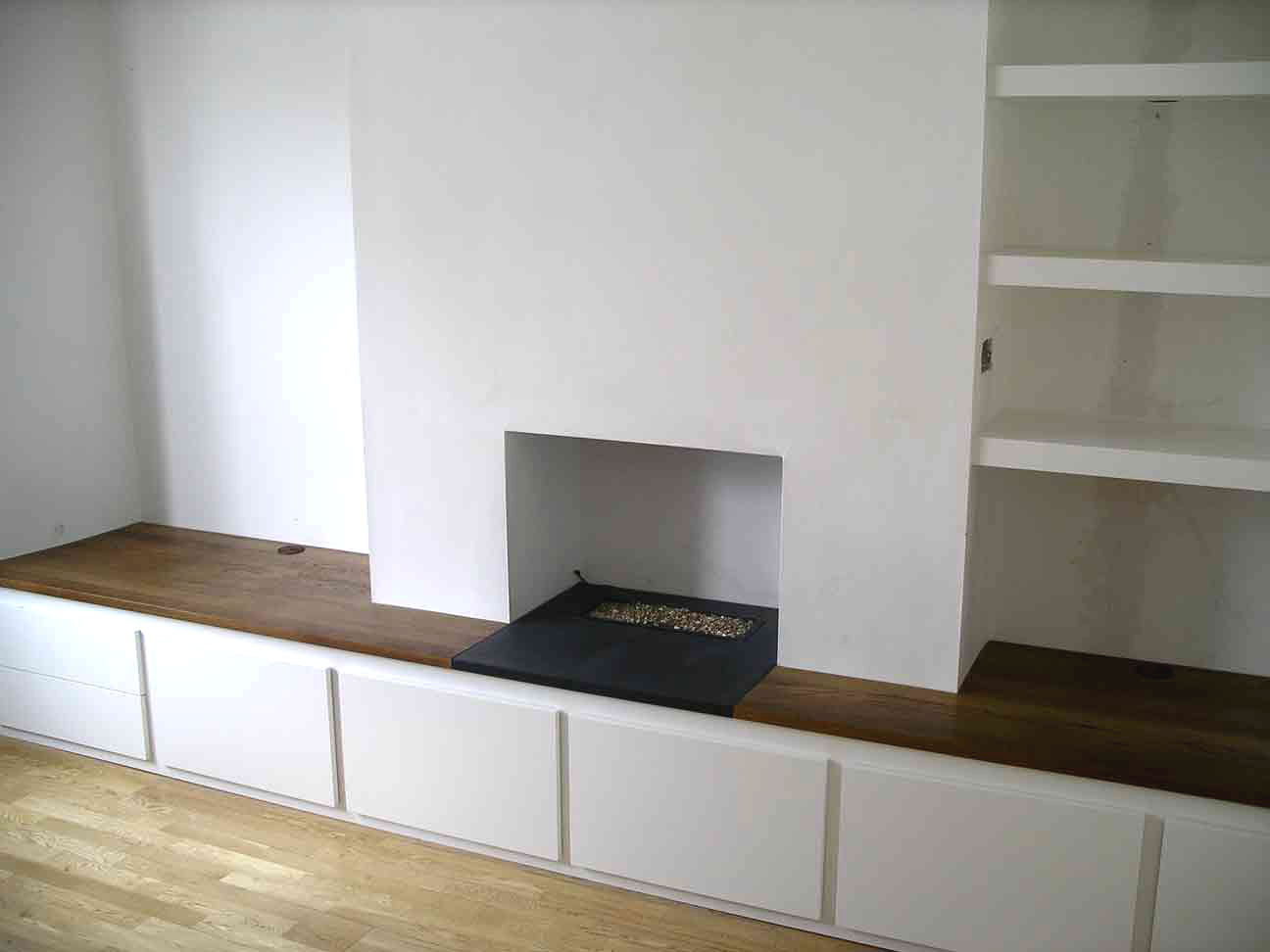 custom built cabinet spans chimney breast and alcoves